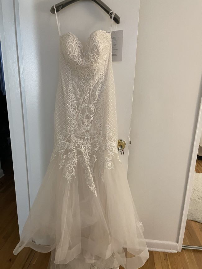 Allure Bridals Gorgeous symmetrical lace patterns strapless gown.