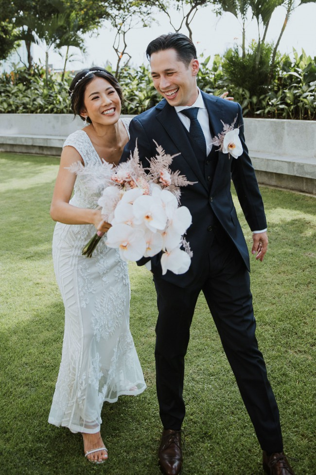Oleg Cassini Heavily Beaded Low Back Sheath Wedding Gown WGIN01